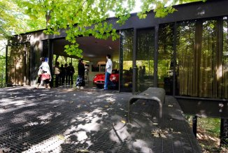 "This Oct. 4, 2009 photo shows visitors touring the pavilion in the back of the modernist home in Highland Park, Ill., that was featured in the movie ""Ferris Bueller's Day Off."" The home, where Ferris Bueller's friend Cameron famously ""killed"" his father's prized Ferrari, sold Thursday, May 29, 2014 for $1.06 million. The house, built in 1953 by Mies van der Rohe-protege A. James Speyer, was first put on the market in 2009 listed at $2.3 million. (AP Photo/Sun-Times Media, Eric Davis) MANDATORY CREDIT, MAGS OUT, NO SALES"
